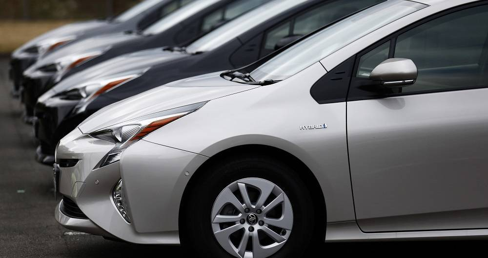 Toyota Motor Corp.'s fourth-generation Prius prototype hybrid vehicles sit parked ahead of a test drive at Fuji Speedway on November 12, 2015 in Oyama, Shizuoka prefecture, Japan.